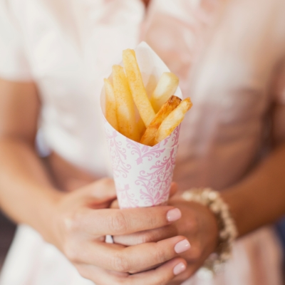bride holding fries boutique wedding catering